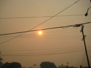 Smoke fills the sky Sunday morning. Here comes the sun.