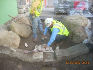 Placing cobble in the forebay.